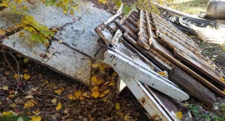 Sections of steel from chip truck