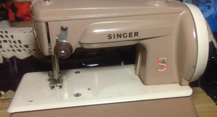 "ANTIQUE TIN TOY ""SINGER"" SEWING MACHINE."