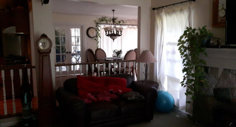 Large bedroom with private sitting room in large house in a park