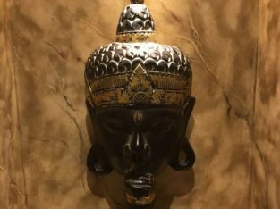 Handcrafted wooden Buddha statue