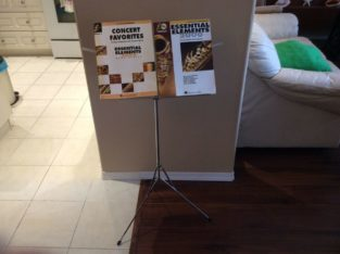 Sheet music stand with books