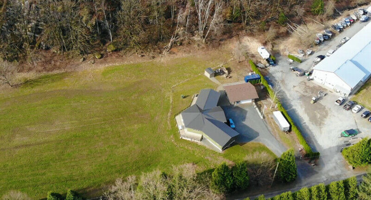 Custom rancher home with a detached shop on 8 Acres