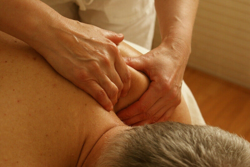 Asian Man's Powerful Hands Offer Relaxation/Therapeutic Massages
